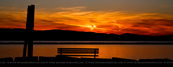 An early March sun sets behind the Adirondack mountains and Lake Champlain.